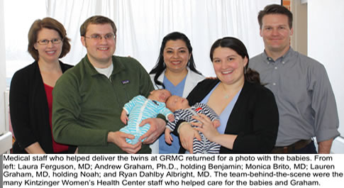 graham family with twins and medical staff that delivered them