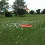 Volunteers drop more than 2,100 golf balls from the helicopter above the 18th fairway at Oakland Acres Golf Club.