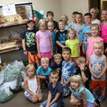 GRMC's Daycamp participants harvested tomatoes, zucchini, beans, peppers, and beets from GRMC's Giving Garden.