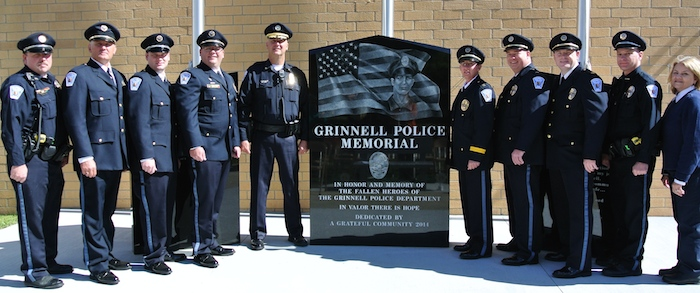 Grinnell Police Officers in full dress uniforms for the Grinnell Police Memorial dedication Saturday October 4, 2014