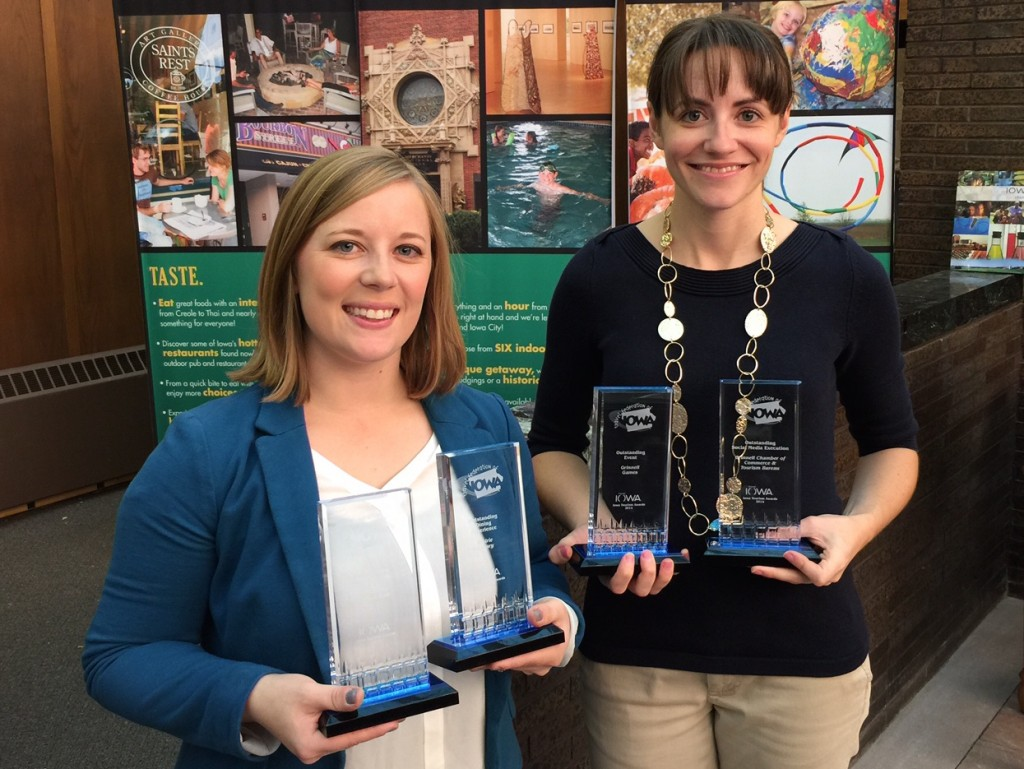 Emily Counts and Rachael Kinnick of the Grinnell Chamber of Commerce hold awards from recent Iowa Tourism Convention in Council Bluffs.