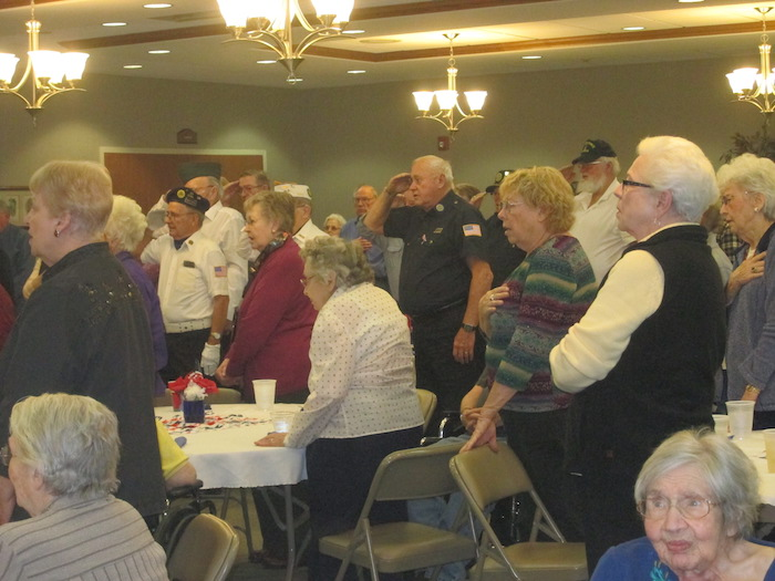 "St. Francis Manor residents, Seeland Park residents, and veterans from the Grinnell community singing the ""Star Spangled Banner"" at a Veterans Remembrance Program held at St. Francis Manor on November 10th."