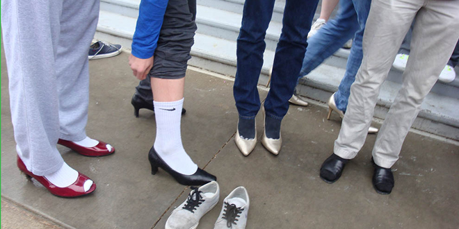 PTK members, Iowa Valley Grinnell faculty, and young men from the Grinnell High School soccer team disregarded the poor weather conditions and managed to complete the one-mile walk wearing high heels.
