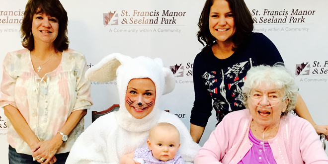 From left:  grandmother Joy Cummings, 8-month-old Rowyn Michalek, mother Courtney Michalek and great-grandmother/St. Francis Manor resident Isabel Waterbeck