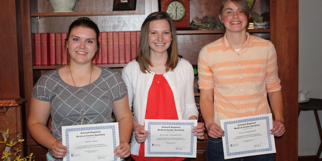 Sydney Meek, Toledo; Brittany Sleeuwenhoek, Hartwick; and Julia Groenenboom, Rose Hill, received their scholarships at the GRMC Auxiliary's annual spring luncheon. Not shown: Allisyn Brandenburg.
