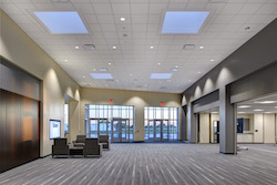 The main entrance opens into the lobby of the Bartelt Conference and Education Center. Guests can find information about the company and local restaurants, attractions, and accommodations as well as agenda schedules, weather updates, and a map of the facility on an 80 inch touchscreen located just inside the entrance.