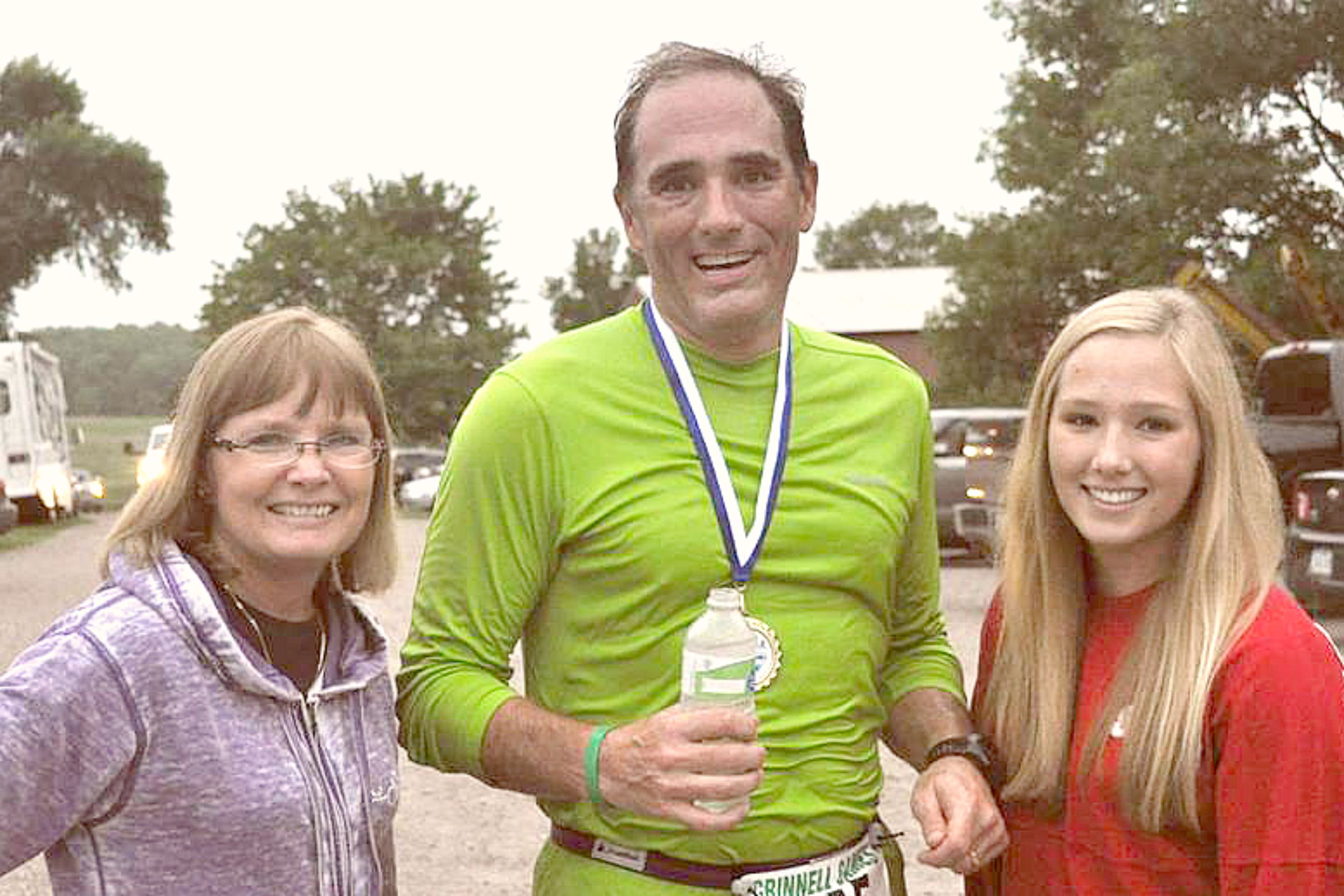 Kim and Austin Jones with Miranda at the Twilight Run (Grinnell Games), 2015