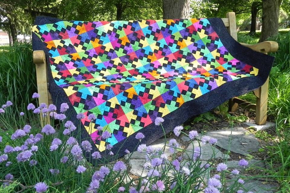 "This ""4-Way"" Quilt, a joint effort by Guild members, was raffled at the event"