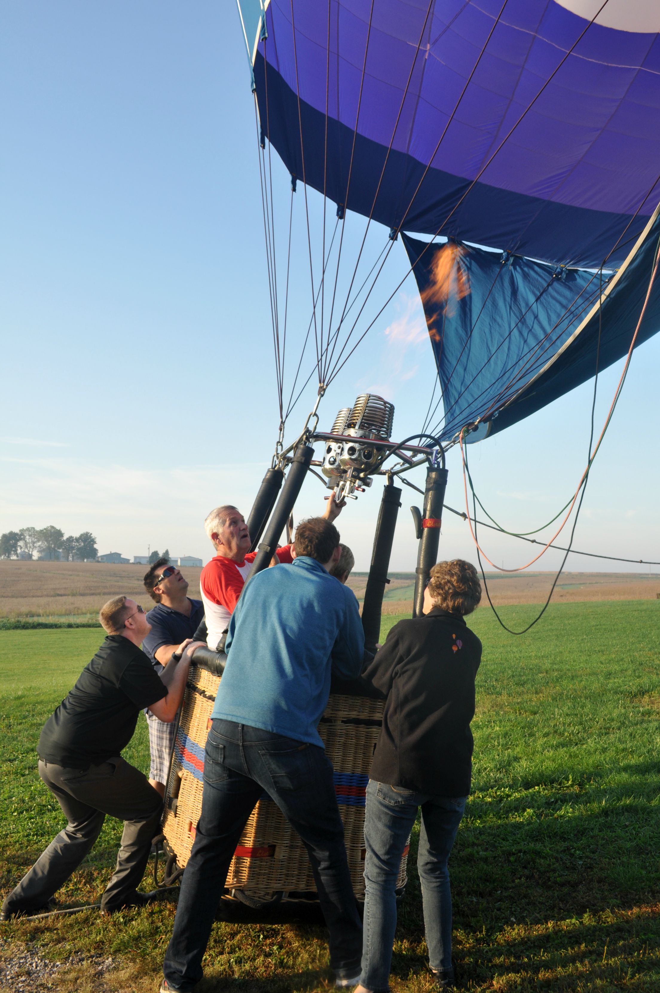 The ground team helps get the balloon upright for take off.