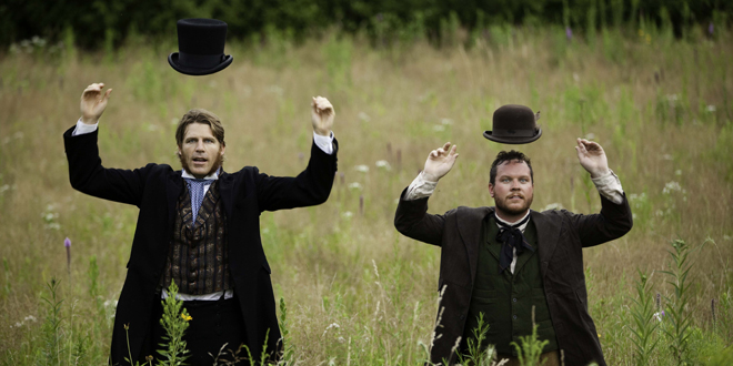 "From left: Ralph Waldo Emerson (Tyson Forbes) and Henry David Thoreau (Grinnell College graduate John Catron) toss their hats overhead as they revel in the wonders of the natural world in ""Nature — A Walking Play."""