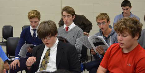 9th graders rehearsing the piece for the concert. Row 1: Sam Pederson, Daniel Rebelsky Row 2: Dane Edwards, David Krumm, Logan Strawser, Gareth James