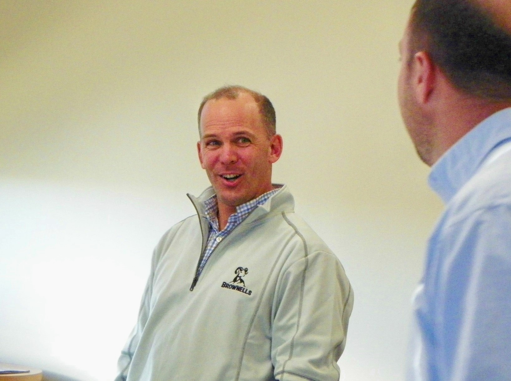 Company CEO Pete Brownell shares a laugh with a visitor.