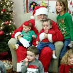 Santa poses with Gary and Jay Glandon's grandchildren. L-R on floor:  Kinnick and Carver Holden, McKinzie Taylor and L-R 2nd row:  Amelia Holden, Wyatt Taylor, Isabelle Holden, Peyton Taylor