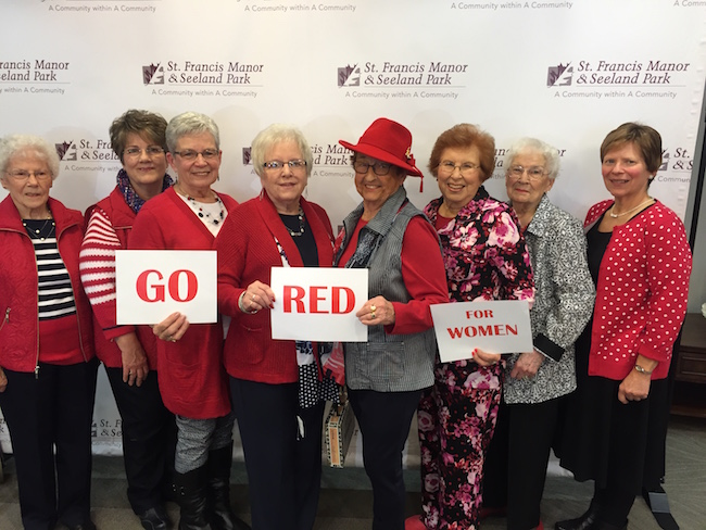 The Seeland Park Ladies in Red were the models: (L-R) Margaret Dyer, Bobbie Deeter, Marie Hotchkin, Wilma Wilson, Betty Hammond, Hazel Lease, Mim Peters and June Watkins.