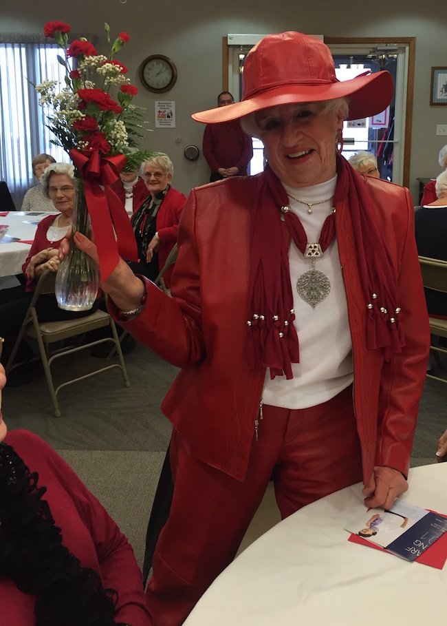 "Bonnie Wold is named one of two ""Razzle Dazzle Red Women"" of the event."