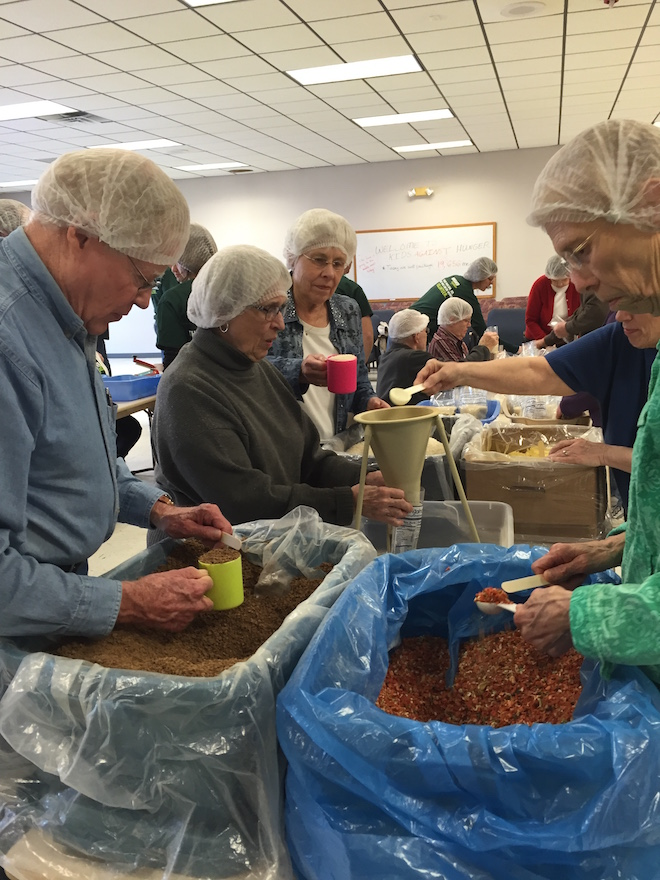 George Drake, M.J. Zimmerman, Sue Drake (on left) and Sue Ahrens (on right) were part of the UCC church packing team.