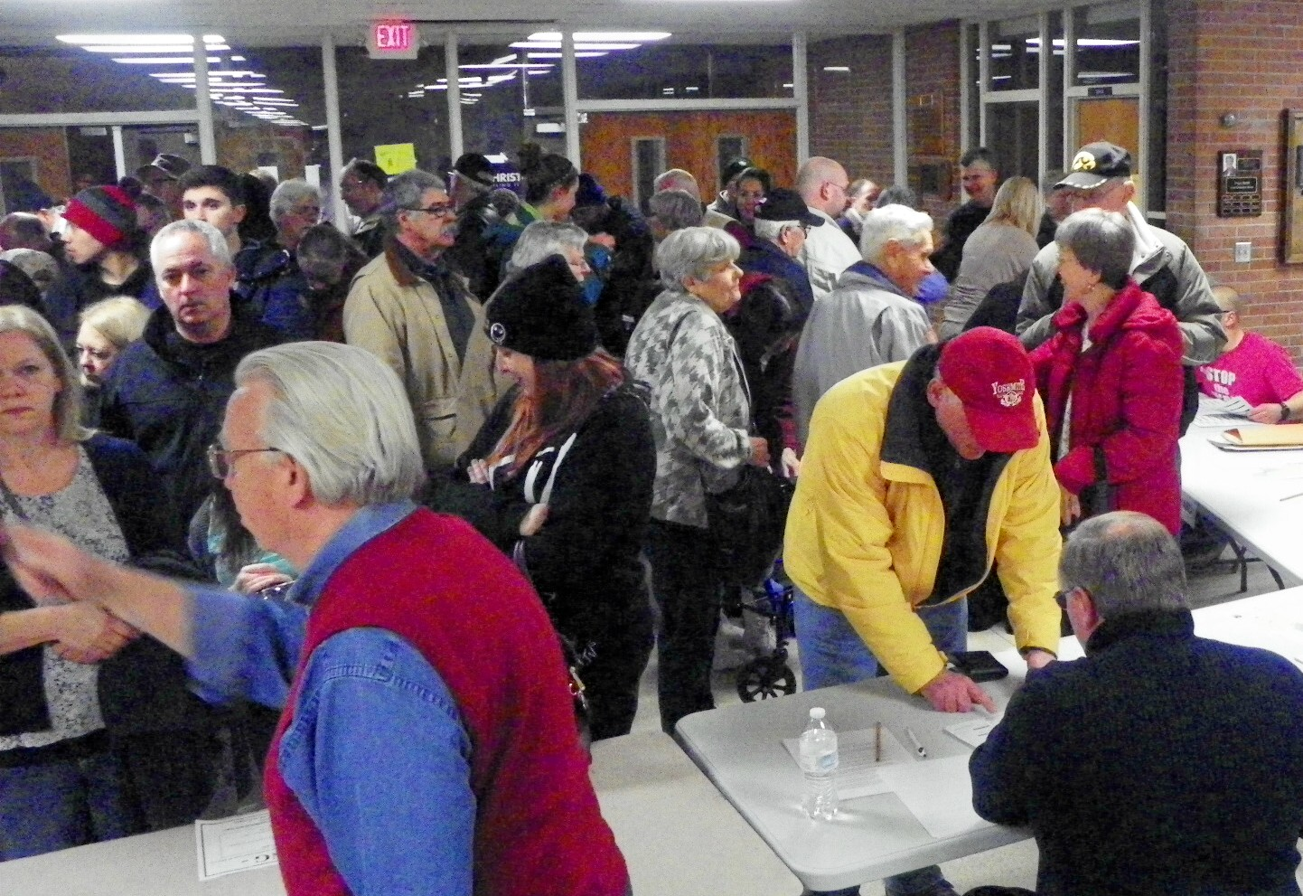 A huge voter turnout swamped workers at the registration table. Photo by Keith Brake