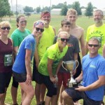 Grinnell Regional Medical Center was awarded the Grinnell Games Company Challenge traveling trophy last weekend. Members of their team accepted the trophy at the conclusion of the games. Those pictured include (front row, l-r) Sherry Baker, Danielle Messico, Megan Jensen, Robert Groves, Chad Nath, Andrew Cogley, Jessica Kite; (back row, l-r) Jarrod Diehm, Dennis Lowry, Jamie McClenathan, Cody Jensen, Seth Signs, Dr. Patrick Cogley, Grace Diehm.