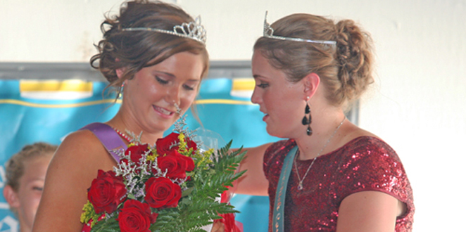 Queen & Catelyn -- Catelyn Graham, the 2015 Poweshiek County Fair Queen, gives Brooke Kuesel of Victor a bouquet of roses after she was named the 2016 Poweshiek County Fair Queen during a ceremony on Thursday, July 21 in Grinnell.