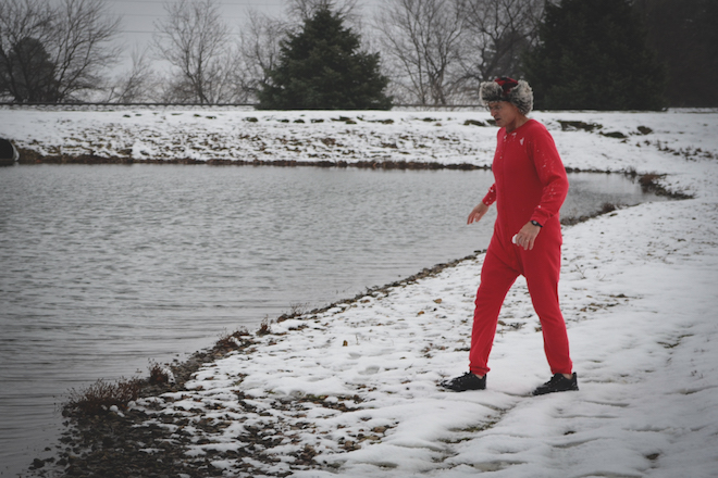 Jeff Menary, Grinnell Mutual executive vice president of line operations, takes the long, cold walk to the Grinnell Mutual Reinsurance pond to uphold his part of the challenge to support GRMC's Community Care Clinic.
