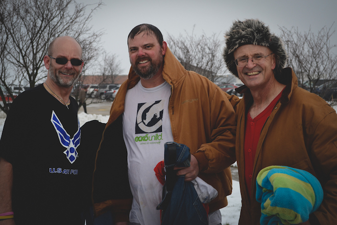 No Shave No Heels November squad leader Ron Nott (right), project lead Matt Petersen (center), and joined Jeff Menary (right) for a plunge into the pond behind Grinnell Mutual as part of the challenge that raised more than $4,100 for the Community Care Clinic.