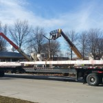A long trailer was needed to haul 80 feet long curved glued laminated beam from Sentinel Structures in Peshtigo to Grinnell, Iowa.